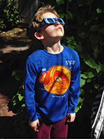Boy wearing eclipse shades