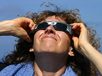 Woman wearing eclipse shades